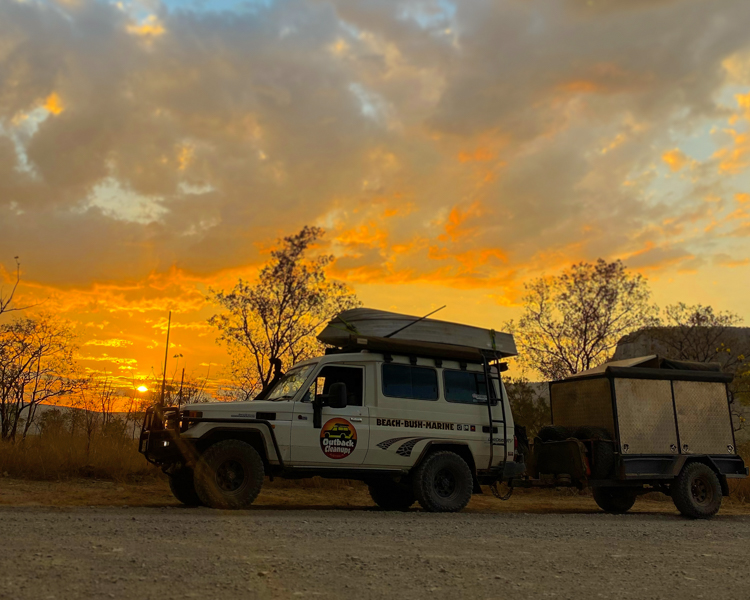 5-Outback-Cleanups-Australia-Sunset-LandCruiser-Towing-Boat-On-Roof